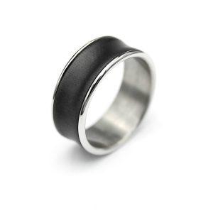 Black concave zirconium ring | Kovera musta zirkoniumsormus. | Design Kultaseppä Goldsmith Petri Pulliainen.